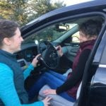Susie, Certified Driver Specialist & Occupational Therapist, works with a driver.